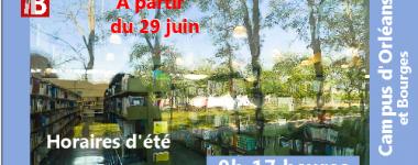 Photographie de l'intérieur de la BU Lettre avec reflets des arbres