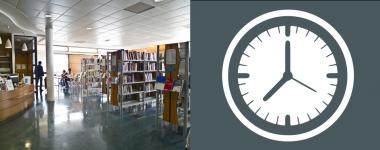 photographie intérieure de la bibliothèque de Bourges et horloge dans la partie droite.